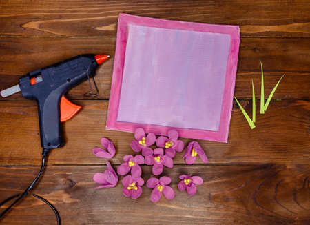 Kid makes Mother's Day or Birthday greeting card. DIY holiday card with pink paper volumetric flowers. Handicraft made by child with scissors, glue and paper. layout. Step 6 of 7
