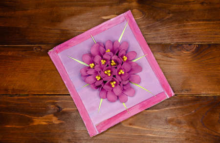 Kid makes Mother's Day or Birthday greeting card. DIY holiday card with pink paper volumetric flowers. Handicraft made by child with scissors, glue and paper. layout. Step 7 of 7