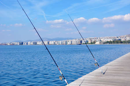 fishing rods: fishing rods on city seafront