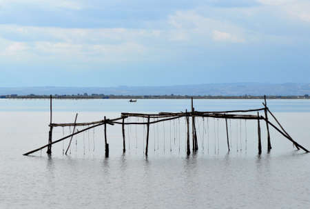 delta: wooden fishing net construction in river delta