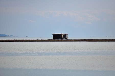 fishing hut: wooden fishing hut on river bank Stock Photo