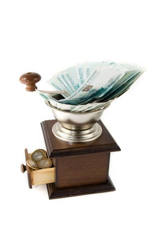depreciation: Depreciation of money - brown grinder with Russian money on a white background