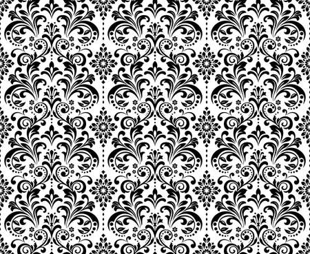 Wallpaper in the style of Baroque. Seamless background. White and black floral ornament. Graphic pattern for fabric, wallpaper, packaging. Ornate Damask flower ornament Banque d'images