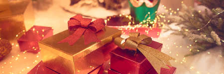 Christmas decorations and present boxes with festive lights