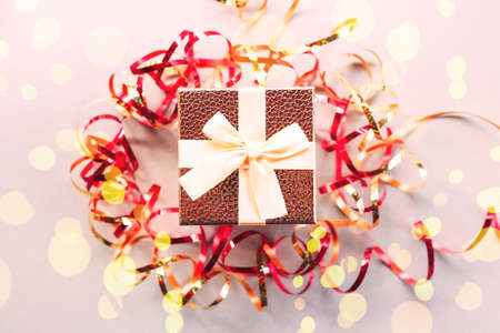 Christmas gift box with festive ribbons and golden stars Archivio Fotografico