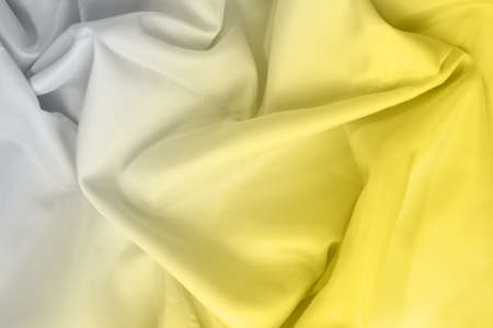 Taffeta silk fabric artistic layout. Texture, background. template. Demonstrating trendy colors 2021 - Gray and Yellow.