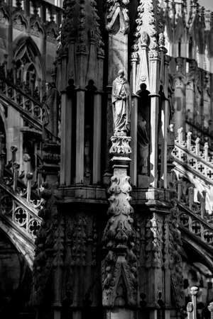 Duomo di Milano, tower fragmet black and white, no color, no people, suny light