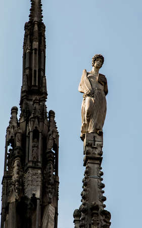 Duomo di Milano, Milan july 2018. Statue on the roof of the Duomo. Редакционное