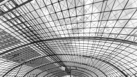 Berlin, Germany, August 18, 2018. Glass ceiling on a sunny day at the central railway station in Berlin uncolored, black and white Редакционное