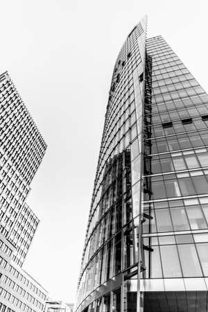 Berlin, Germany, August 21, 2018. Two modern high-rise buildings black and white. Редакционное