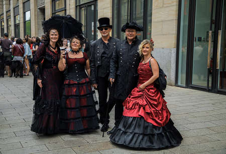 Leipzig, Germany , Juny 9, 2019 . Festive people in black and red gothic costumes at the street