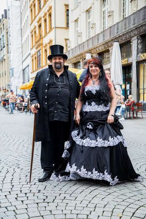 Leipzig, Germany , Juny 9, 2019 . Festive people in black and red gothic  and steampunk costumes at the street