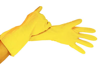 female hands in yellow working rubber gloves for cleaning and cleanliness of the room, photo close up in studio isolated on white background light