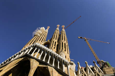 Barcelona, Spain. November 14, 2017. Entrance to the Sagrada Family by Gaudi, Basilica in sunny day, no people, against the sky, no clouds, close-up