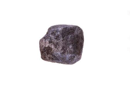 super macro shot single crystal black hawaiian salt very close on white background isolated Фото со стока