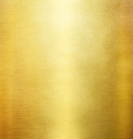 Gold polished metal texture or abstract stainless steel background. Foto de archivo