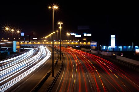 Traffic in motion on a long exposure on a night highway in the city.