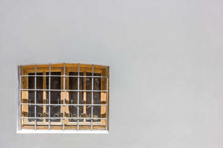 lattice window: window with bars on a gray wall Stock Photo