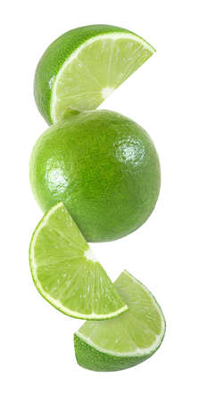 hanging, falling and flying piece of lime fruits isolated on white background