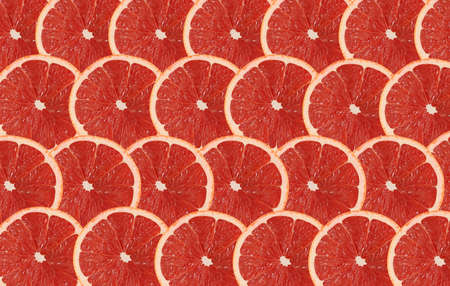Grapefruit fruits slice abstract seamless pattern background. Top view.