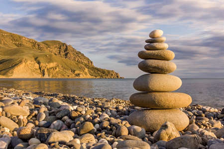 pebble stack on the sea coast line and mountains