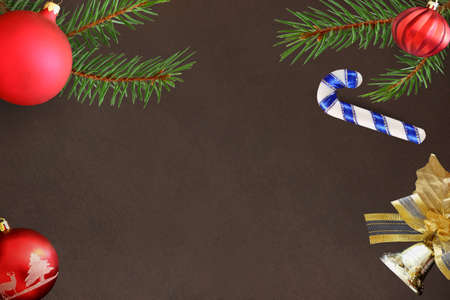 dull: Christmas fir branch, stick, red wavy dull ball, bell decoration on a dark background
