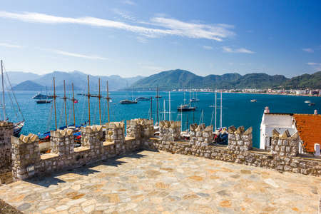 The view from the Turkish Fort of the fortress of Marmaris Bay, the promenade and the surrounding area with the mountains and yachts 写真素材
