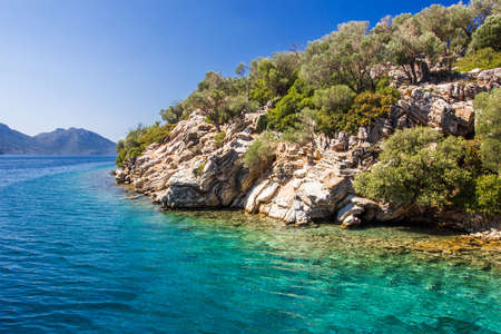 Rocky shore of the island in the Aegean sea on a clear day