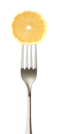 Lemon cut on impaled on a fork isolated on white background. 写真素材