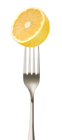 Lemon yellow cut single on impaled on a fork Stockfoto