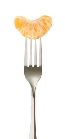 Mandarin or tangerine slice purified impaled on a fork
