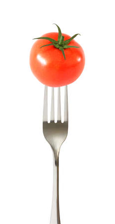 Tomato whole one impaled on a fork isolated on white background