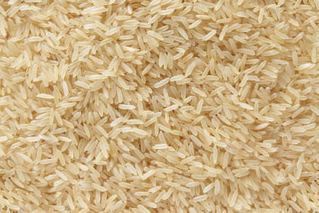Rice fragrant basmati scattered top view raw background