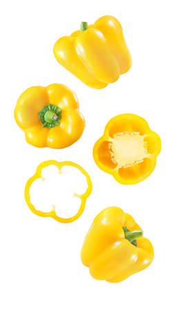 Pepper bell yellow the set of the falling, soaring, hanging, flying whole and cut pieces slices isolated on white background