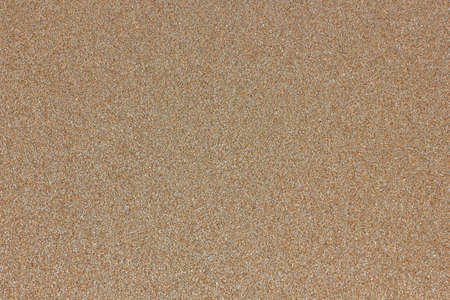 Yellow sand marine structure background of the homogeneous beige 스톡 콘텐츠