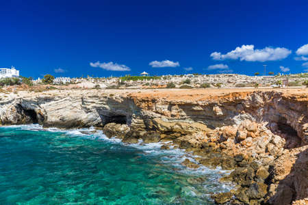 Rocky shore, clear turquoise sea water and blue sky in Ayia-Napa, Cyprus, sculpture park.