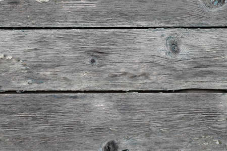 Surface is made of old boards, dry, crooked, rough.