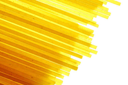 Spaghetti pasta macaroni spilled to the lumen in the contour light  isolated on white background.