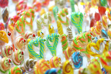 Candy colored on a stick in the form of hearts and different shapes. 版權商用圖片