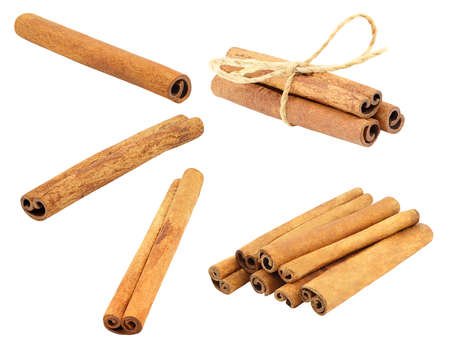 Cinnamon sticks are single and in a pile, tied with a rope isolated on white background