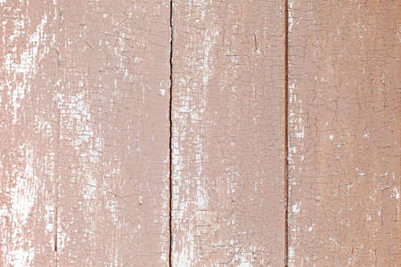 Background of wooden planks with old peeling brown paint
