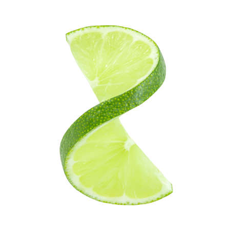 Lime slice cut off turned out isolated on a white background. The element of packaging design. Full depth of field. Foto de archivo