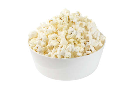 Popcorn, cooked corn, poured into a white bowl, isolated on white background