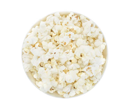 Popcorn corn cooked, in a white bowl, isolated on white background. Top view. Foto de archivo