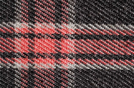 Fabric with checkered pattern red, background structure, , close-up macro view