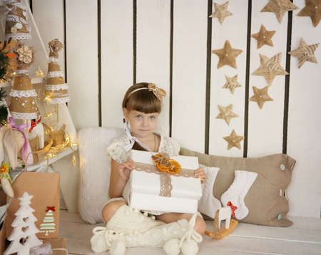 little girl opens a Christmas gift Stock Photo