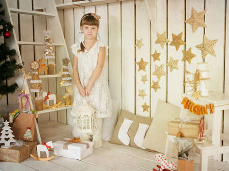 girl with a lamp in his hand standing in vintage decorations photo