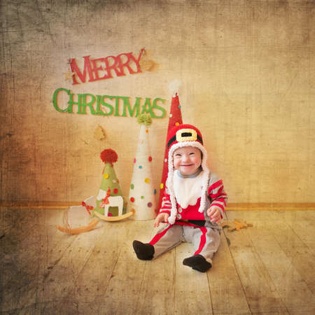 Little girl with Down syndrome laughs heartily in Santa Claus costumes Stock Photo