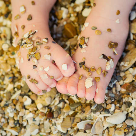 small childrens feet in the sand Stock Photo