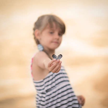 girl holding a conch shell Stock Photo